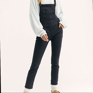 Free People washed denim overalls in black.